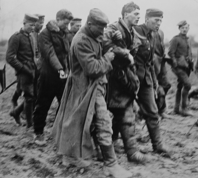Photographer unknown, </span><span><em>Wounded English aviator taken prisoner by German soldiers, 1914-1918</em>, </span><span>Gelatin Silver Print, 5x5 inches