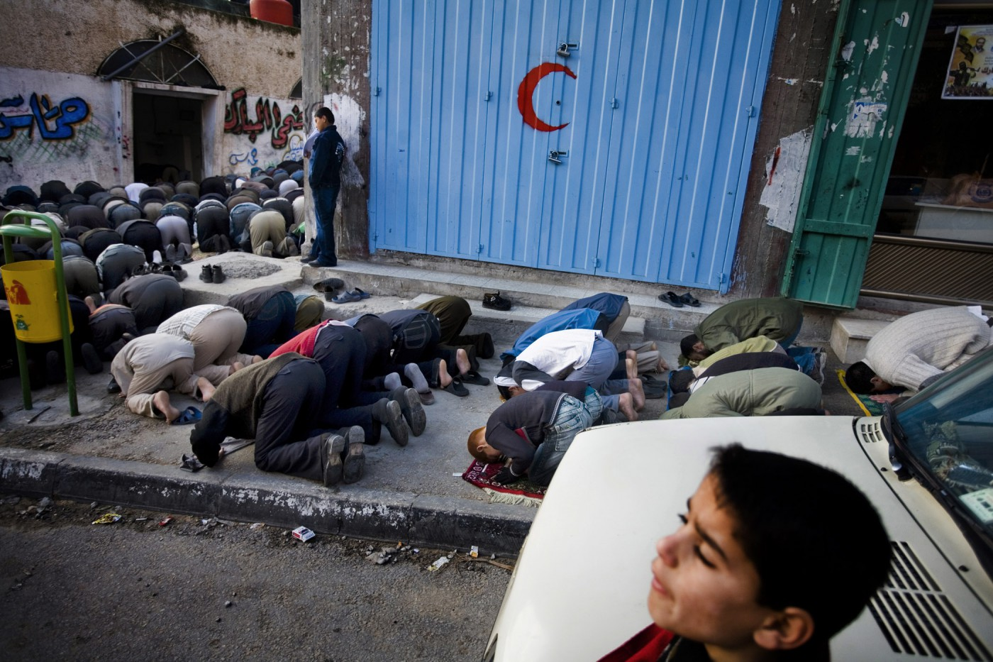 Dominic Nahr, </span><span><em>Come to Prayer / Come to Success, The Gaza Strip, 2007</em>, </span><span>Digital Print