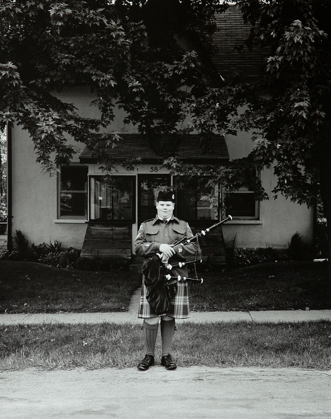Tom Zsolt, </span><span><em>Cadet with Bagpipes, 2003</em>, </span><span>Silver Print,   13.5