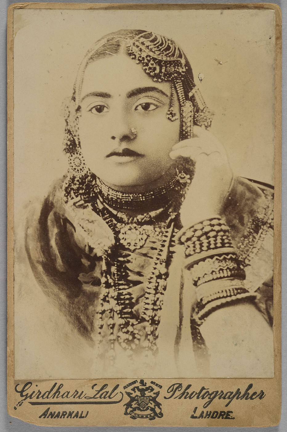 Photo by Girdhari Lal., </span><span><em>Portrait of a Woman, c1885, Lahore, India</em>, </span><span>Albumen print mounted on board, 4 x 6 inches.