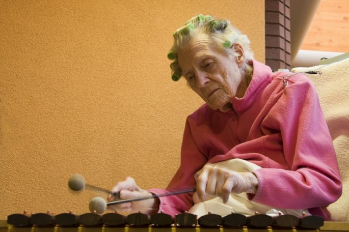 Cathy Greenblat, </span><span><em>Jeanette playing the xylophone, USA, Love, Loss and Laughter</em>, </span><span>