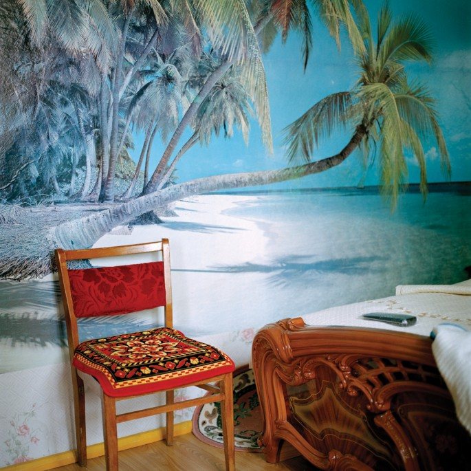 Olga Chagaoutdinova , </span><span><em>Chair at the beach in the bedroom, 2006 Russian Pictures</em>, </span><span> Courtesy of the Artist