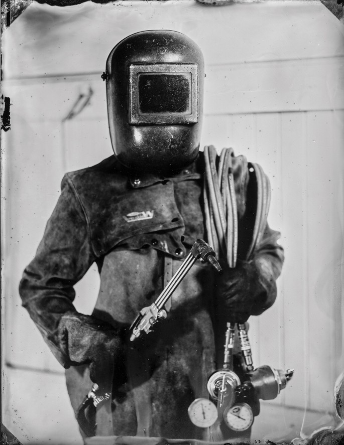 The Tintype Studio, </span><span><em>Welder</em>, </span><span>2013
