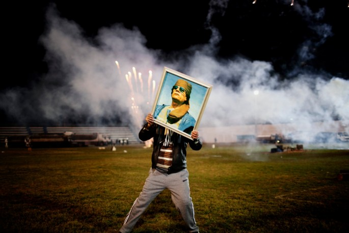 Moises Saman , </span><span><em>A Qaddafi supporter holds a portrait of the Libyan leader</em>, </span><span>March 9, 2011 Courtesy of Magnum Photos