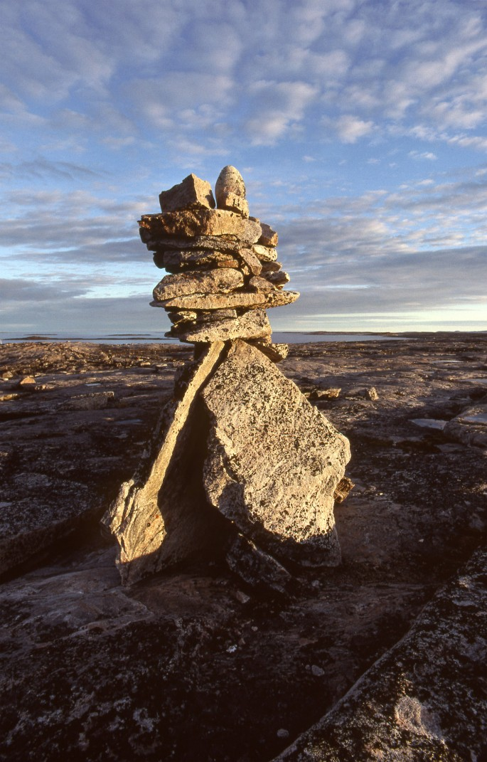 Norman Hallendy, </span><span><em>An inuksuapik, the most beautiful kind of inuksuk, at a revered site near Saatturittuq, southwest Baffin</em>, </span><span>1995 Gift of Norman Hallendy, 2009. McMichael Canadian Art Collection Archives