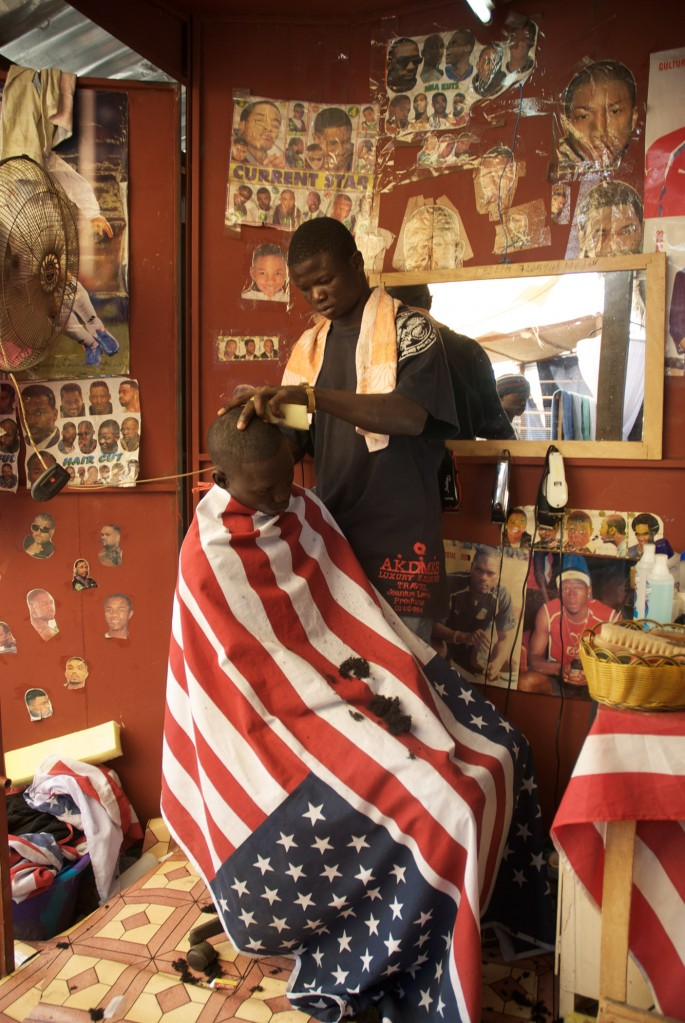 Vanley Burke, </span><span><em>Untitled, Barbershop in Gambia</em>, </span><span>2007 Courtesy of the artist