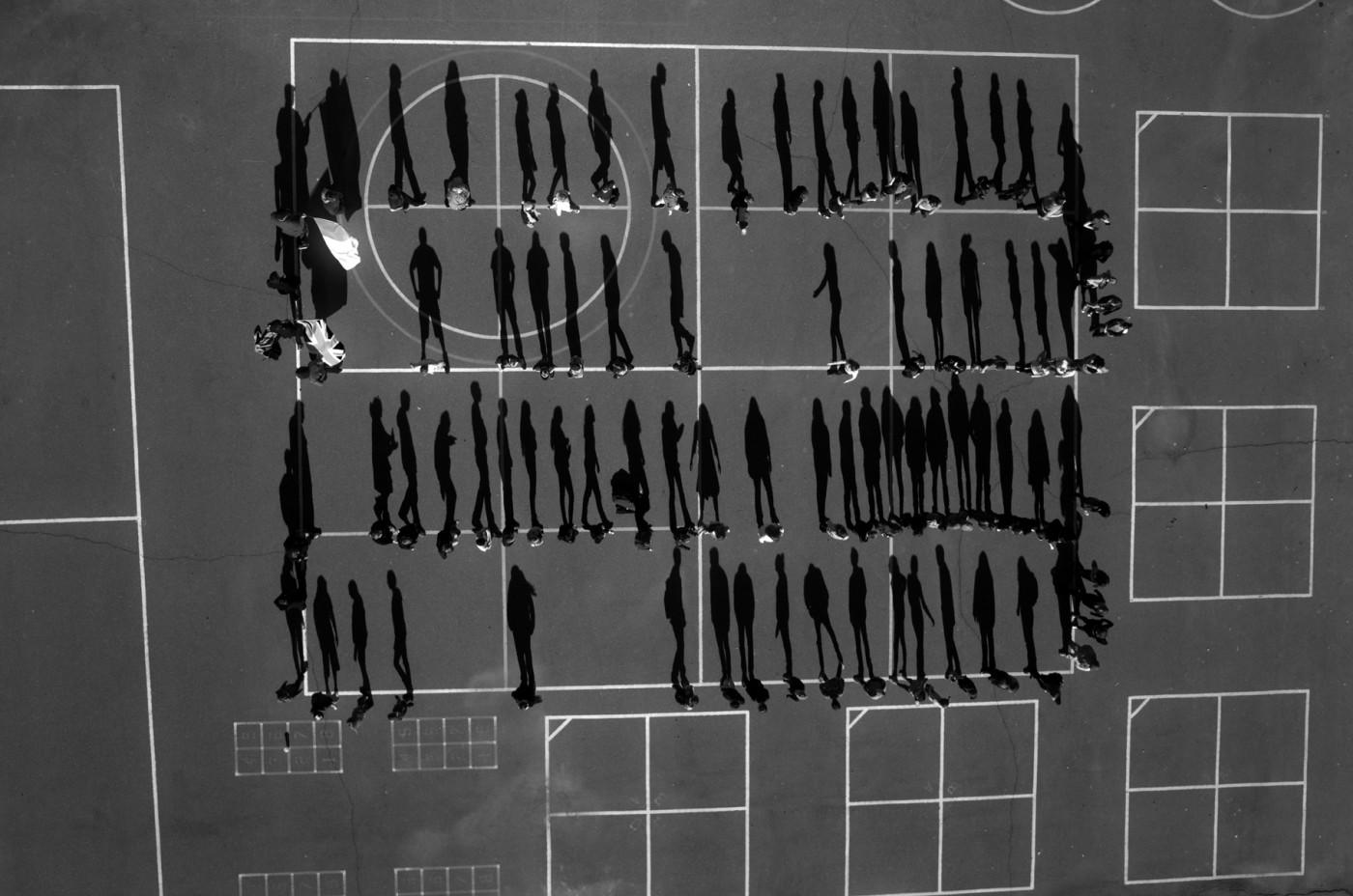 """Tomas van Houtryve, </span><span><em>School Yard</em>, </span><span>2013 - 2014. Archival pigment print, 40 x 40""""."""