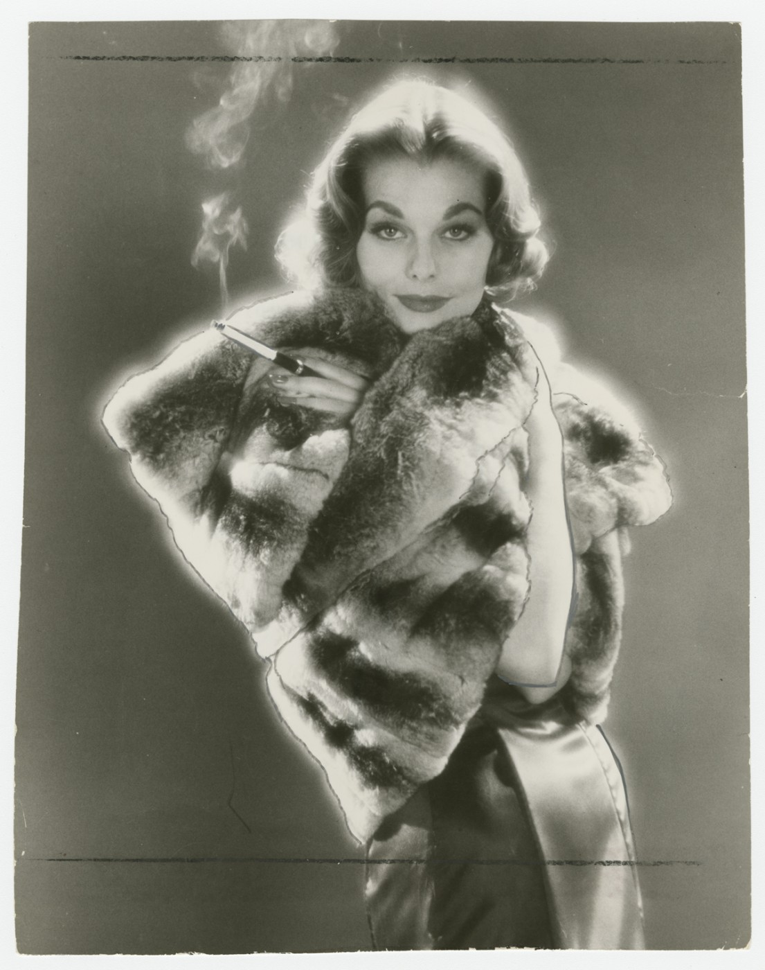 Unidentified Photographer, </span><span><em>Jacques Heim designed chinchilla stole, which may be worn in different ways</em>, </span><span>1958. Gelatin silver print, 9 x 7&quot;. Gift of The Globe and Mail newspaper to the Canadian Photography Institute of the National Gallery of Canada.