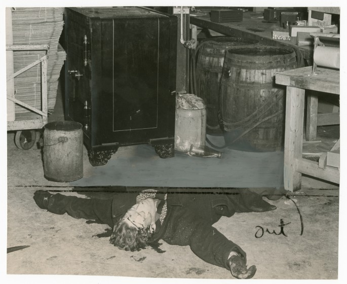 Unidentified photographer, </span><span><em>Dead body of William Poole after he was shot by police while trying to open safe of Toronto Florist Co-operative</em>, </span><span>1948. Gelatin silver print, 7 × 8.5&quot;. Gift of The Globe and Mail newspaper to the Canadian Photography Institute of the National Gallery of Canada.