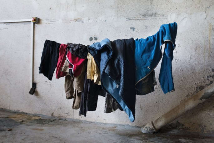 "Nick Kozak, </span><span><em>Clothesline</em>, </span><span>2015. Archival Pigment Print, 32 x 48""."