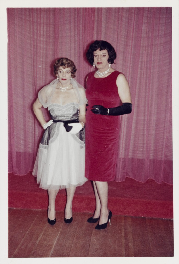 Unknown American, </span><span><em>Anita and Gloria Standing by the Stage</em>, </span><span>October 1961. Chromogenic Print, 12.1 x 8.3 cm. Collection of the Art Gallery of Ontario. Purchase, with funds generously donated by Martha LA McCain, 2015. © Art Gallery of Ontario