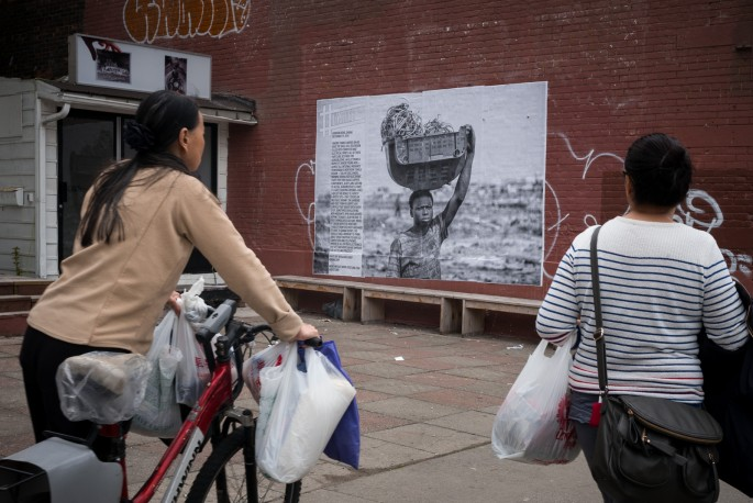 A photograph by Ben Lowy installed in front of 8eleven Gallery at 233 Spadina Avenue, Toronto. , </span><span><em>Photo: Benjamin Petit</em>