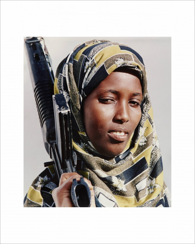 Dan Eldon, </span><span><em>Untitled (Somali woman holds a rifle)</em>, </span><span>1992