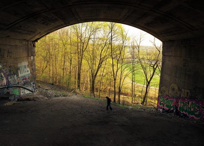 Robert Burley, </span><span><em>Homeless man beneath the Prince Edward Viaduct</em>, </span><span>2013. Courtesy of the Stephen Bulger Gallery.