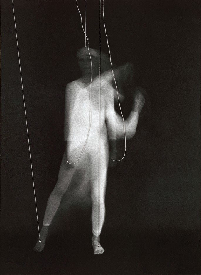 Suzy Lake, </span><span><em>Puppet Study #10</em>, </span><span>1976. Gelatin silver print, string, photo oil tint, 8.75 x 6.5&quot;. Courtesy of Georgia Scherman Projects and the artist.